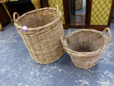 A LARGE WICKER TWIN HANDLED LOG BASKET AND ANOTHER SMALLER EXAMPLE. (2)`