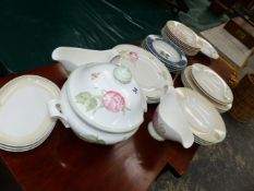 A VILLEROY AND BOCH FLOREA PATTERN PART DINNER SERVICE WITH GREEN RIM BANDS ENCLOSING FLOWER