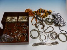 A COLLECTION OF WHITE METAL AND BEADED ETHNIC STYLE JEWELLERY TO INCLUDE BANGLES, EARRINGS, ETC.