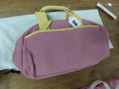 A RADLEY PINK TEXTILE HANDBAG WITH LIME LEATHER HANDLES AND EDGINGS, THE INTERIOR LINED WITH