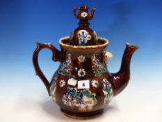A BARGE WARE TEA POT AND COVER SURMOUNTED BY A TEA POT FINIAL, THE BROWN SIDES WITH COLOURED