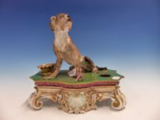 A FRENCH JACOB PETTIT INKSTAND SURMOUNTED BY A DOGUE DE BORDEAUX SEATED ON THE GILT GREEN TOP WITH A