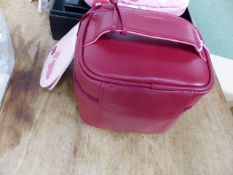 A RADLEY FOLD AWAY PINK BAG MADE FROM WASTE PLASTIC BOTTLES, A RED LEATHER ZIP UP MAKE UP BAG