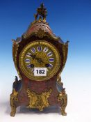 A BOULLE BALLOON CASED CLOCK BY MOUGIN, THE PENDULUM MOVEMENT STRIKING ON A COILED ROD, THE FACE