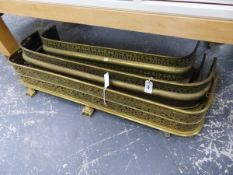 FOUR VICTORIAN PIERCED BRASS FIRE FENDERS.
