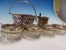 A HALLMARKED SILVER MUSTARD, A BLUE GLASS LINED SILVER BASKET AND FOUR SILVER MOUNTED GLASS SALTS.