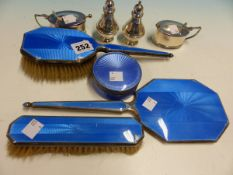 A HALLMARKED SILVER AND ENAMEL DRESSING TABLE SET, TWO SILVER MUSTARDS AND TWO PEPPER POTS.