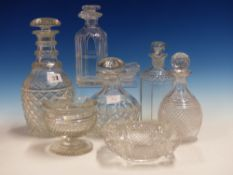 FIVE DECANTERS, THREE BOWLS, A SALT AND A CLEAR GLASS SWEETMEAT, THE WIDEST BOWL. 22cms.