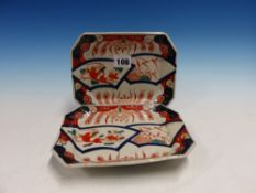A PAIR OF JAPANESE IMARI CANTED RECTANGULAR DISHES DECORATED WITH PAIRS OF FANS. W 18.5cms.