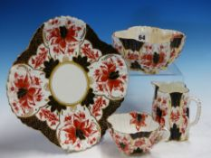 A WILEMAN IMARI PALETTE TWELVE PLACE TEA SET, THE CORNERS OF THE FLUTED SQUARE SHAPES PRINTED IN RED
