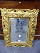 A RECTANGULAR MIRROR IN A BAROQUE STYLE GILT WOOD FRAME PIERCED AND CARVED WITH FOLIAGE. H 53 x 44.