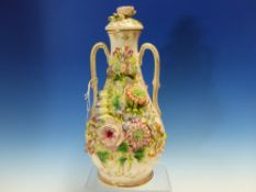 A STAFFORDSHIRE FLORAL ENCRUSTED TWO HANDLED BOTTLE VASE. H.30cms.