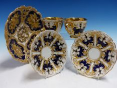 A PAIR OF MEISSEN CUPS AND SAUCERS RELIEF DECORATED WITH BLUE AND GILT PANELS TOGETHER A SIMILARLY