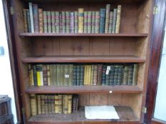 A COLLECTION OF LEATHER AND CLOTH BOUND BOOKS BY DICKENS, TROLLOPE, BOSWELL, MARRYAT, POPE AND