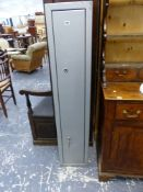 A CLAY SHOOTERS SUPPLIES STEEL GUN CABINET, THE DOOR WITH TWO LOCKS. W 31 x D 28 x H 152.5cms.