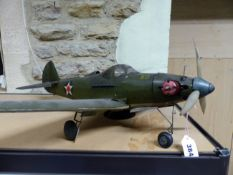 AN AMERICAN WORLD WAR II WAR PLANE, THE THREE BLADED PROP POWERED BY A LIVE FUEL ENGINE, THE