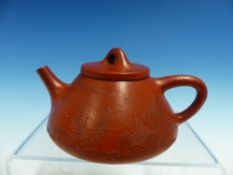A YIXING TEA POT AND COVER, THE SLOPING SIDES RELIEF DECORATED WITH ISLANDS, SEAL MARK. Dia.