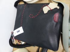 A DEBENHAMS BLACK LEATHER SHOULDER BAG SEWN IN RED AND FAWN LEATHER WITH A DACHSHUND ON A LEAD BY