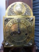 A 19th.C.CARVED OAK LONGCASE CLOCK OF SMALL PROPORTIONS (GRANDDAUGHTER) WITH 8-DAY STRIKING MOVEMENT