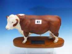 A BESWICK POLLED HEREFORD BULL STANDING ON A WOODEN BASE. W 30cms.