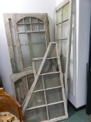 A GROUP OF VINTAGE PINE PAINTED SUMMERHOUSE/ CONSERVATORY GLAZED PANELS OF VARYING SIZES, TO INCLUDE