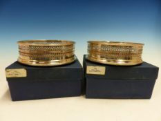 TWO HALLMARKED SILVER WINE COASTERS.