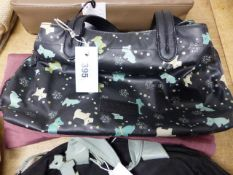 TWO RADLEY BLACK TEXTILE BAGS, ONE TRIMMED IN PALE BLUE LEATHER, THE OTHER DECORATED WITH BLUE,