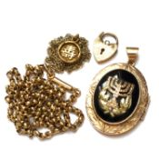 A 14K GOLD EARLY 20th C. JUDAICA MENORAH GOLD AND ONYX LOCKET SUSPENDED ON A 15ct GOLD VICTORIAN