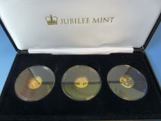 THE QUEENS CORONATION JUBILEE SOLID GOLD COIN COLLECTION, STRUCK IN 9ct GOLD, CASED AND IN CAPSULES.