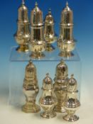 THREE PAIRS OF VINTAGE HALLMARKED SILVER TABLE PEPPERS AND TWO FURTHER SINGLE EXAMPLES.