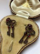 A PAIR OF ANTIQUE BOHEMIAN GARNET SET DOUBLE KEY ARTICULATED EARRINGS FINISHED ON EARRING WIRES.