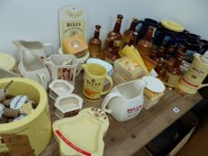 A LARGE COLLECTION OF BELLS WHISKEY BREWERYANA AND A SET OF MARTELL BRAND NATIONAL WINNER PUB JUGS.