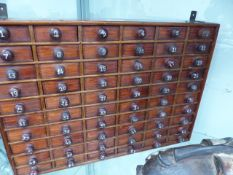 AN ANTIQUE MINIATURE NEST OF 60 DRAWERS.
