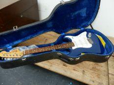 A COPY OF A FENDER STRATOCASTER BLUE BODY GUITAR.