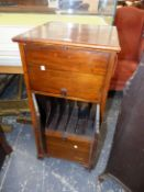 A MAHOGANY CABINET TO TAKE A GRAMOPHONE, THE FRONT WITH CENTRAL DOORS OPENING ONTO RECORD RACKS WITH