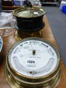 AN ELLIOTT BRASS CASED SHIPS TIMEPIECE ANOTHER BY GENERAL ELECTRIC TOGETHER WITH A SEWILL BRASS