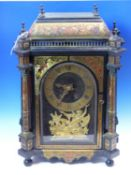 AN 18th C. AND LATER BOULLE CASED MANTEL CLOCK SIGNED J ARTUS PARIS BELOW A FIGURE OF ATLAS