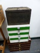A SMALL CAST IRON SAFE AND TWO NESTS OF COLLECTORS DRAWERS.