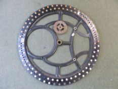 A GEAR WHEEL FROM A CLOCKING IN CLOCK, THE RIM WITH PAPER NUMBER ROUNDELS, THE WHEEL. Dia. 67cms.