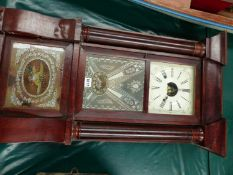 A GLAZED MAHOGANY WALL CLOCK BY BIRGE, BECK & Co. BRISTOL, CONN. THE PENDULUM MOVEMENT STRIKING ON A