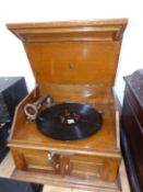 AN OAK CASED PATHEPHONE WIND UP GRAMOPHONE WITH START/STOP LEAVER ABOVE DOORS OPENING TO RELEASE
