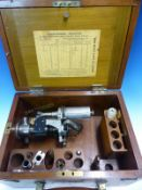 A DOBBIE-MCINNES, GLASGOW, EXTERNAL SPRING EXPLOSION ENGINE INDICATOR IN MAHOGANY BOX WITH SOME