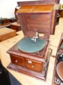 A MAHOGANY CASED GRAMOPHONE Co. Ltd. WIND UP GRAMOPHONE, DOORS BELOW THE GREEN BAIZE TOPPED