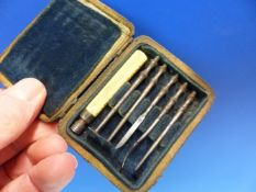 A SHAGREEN CASE OF DENTAL DESCALING INSTRUMENTS, EACH BLADE SCREWING INTO THE SEPARATE BONE