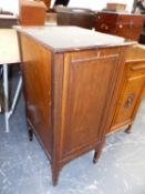 A MAHOGANY RECORD CABINET ON FOUR TAPERING SQUARE LEGS, THE PULL DOWN FRONT REVEALING A BAIZE