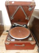 A LEATHER CASED COLUMBIA WIND UP GRAMOPHONE WITH RECORD HOLDER WITHIN THE LID, THE BROWN BAIZE