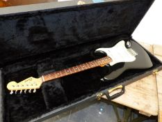 A SQUIRE STRAT BLACK BODY ELECTRIC GUITAR IN CARRYING CASE.