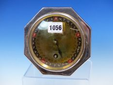 A DAY DIAL CALENDAR , THE CIRCULAR DIAL NAMING THE DAY, DATE AND MONTH, WITHIN AN OCTAGONAL FRAME,