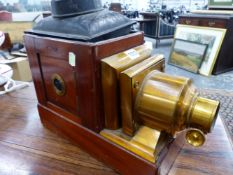 A MAHOGANY MAGIC LANTERN WITH LACQUERED BRASS LENS MOUNTS. W 41cms.