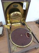 A CROCODILE LEATHER CASED DECCA WIND UP GRAMOPHONE WITH BRASS SOUND BOX WITHIN THE HINGED LID, THE